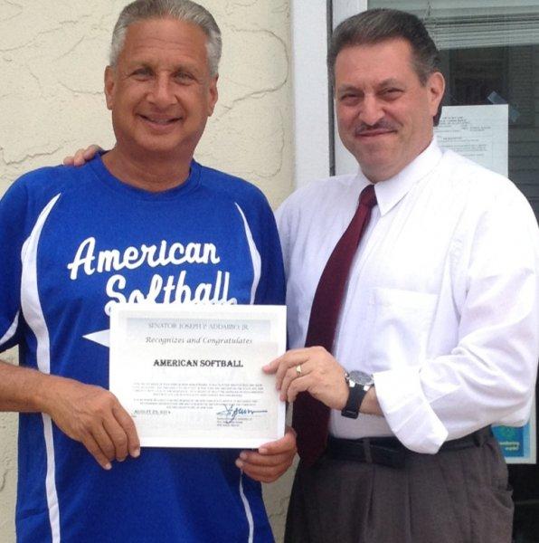 American Softball Founder Randy Novick receiving a Citation from Senator Joe Addabbo