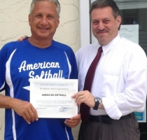 American Softball Founder Randy Novick receiving a Citation from Senator Joe Addabbo